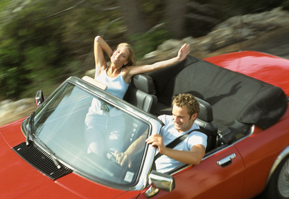 couple in convertible sports car